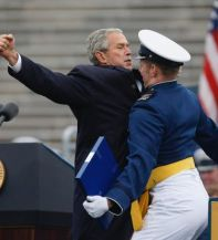 That\'s right, the president chest-bumping a graduate.  Boo-yah.